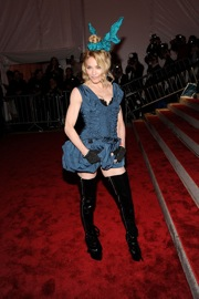 Madonna can dress the boys in Louis Vuitton...that'll take 'em out for sure.