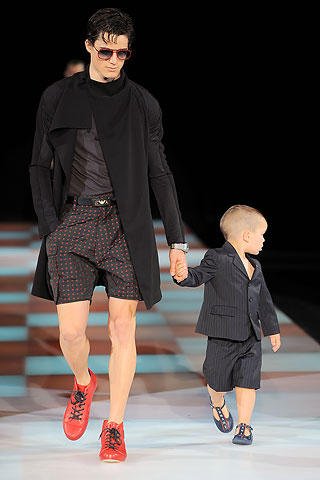 Emporio Armani shows that the stay at home dad can morph into a stay at home mom, not that there's anything wrong witih it. I know, taking care of the kids is a job. So if you want to dress like mommy...be my guest. And little Johhny here is a Manzie-in-training.