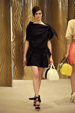 Overall Prada's color palette paled to this smart little black ensemble.