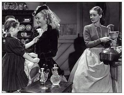 Here, Miriam Hopkins is upstaging Bette Davis. See what I mean? Look at Bette's face.