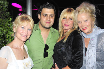 With Sally Kirkland in tow...yowza. So you see kids, in prder to be an effective event producer, all you need is a gaggle of hags and a few bucks to hire a photo service agency. Secret revealed.