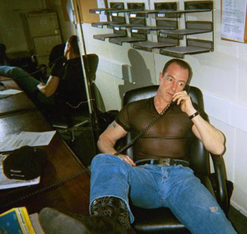 Here Michael Lohan is pretending to work. Notice the empty shelves. But what I think is quite hilare, is that he took a shirt right off the Spring Manzie shows in Milan...and is tragically on trend.
