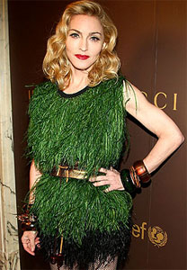 Here's where the Madonna let's the designer do the job that a stylist might cringe and make not happen.