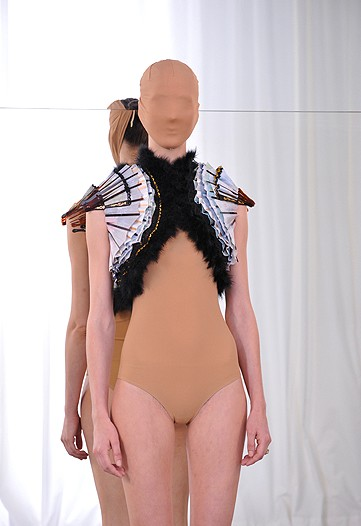 Here, Margiela stole two of Lagerfields fans and sticked them together. Voila...couture...for idiots maybe.