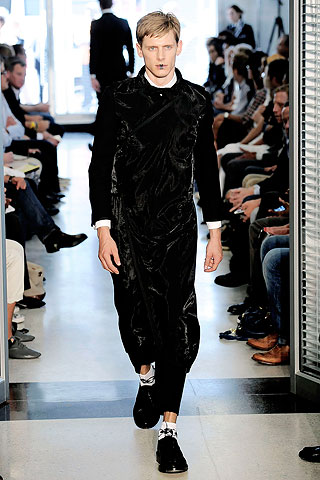 "And so did Tim Blanks when he said: ""a full-length Japanese-influenced wrap dress in black nylon had a sinuously weird charm as an alternative—make that very alternative—evening option."" My response...Tim, let's you you prance around in that get-up."