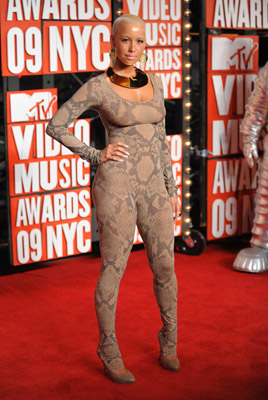 Amber Rose...yes...snake skin is on trend, but this look is for that special 20 year old model...and maybe not even then.