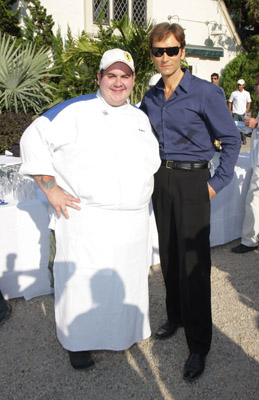 "Talk about opposites attract. Here we have Chef Robert Hesse and ""fitnes guru"" John Basedow. Now, far be it from me to be evil...but...yikes. A) Te chef and the Ferrari...not a match...and the fitness guru...needs to eat something. This image says so much yet so little."