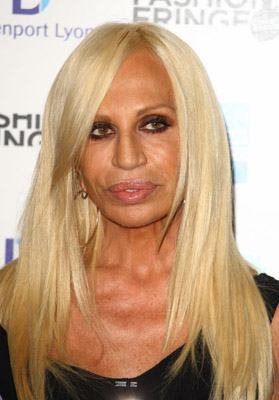 Donatella Versace is cheeks, lips, neck, breasts, up, down, in, out.