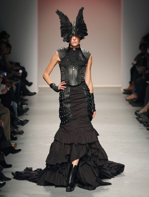 Here is Skingraft. And an appropriate name at that...as it hurts to look at this yaba daba doody. Duh...you think this head dress was inspired by the Gareth Pugh ridiculoousness form Paris? Give me a break.
