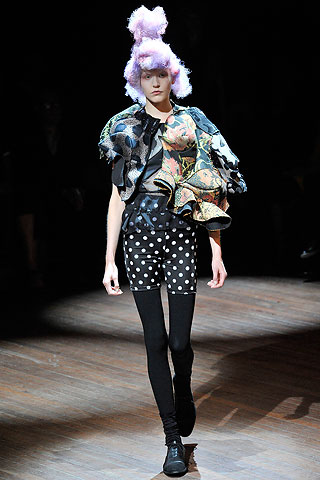 Comme de Garcons is an intellectual designer...I know, I know. His New York store is on my block. When walking my dog Woodstock, I tip in every so often. Next season, I can't wait to see these polka dot bike shorts in stock and I do hope they carry the wigs too.