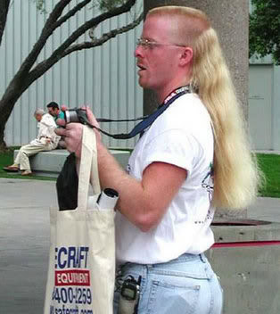 The lovelly mullet. How this guuy and certain lesbians go for that look is beyond me. Loook in the background, that man is breching, surly from The Mullet Man.