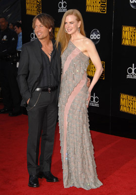Nicole Kiman look stunning in this Balenciaga column, and that accessory, Keith Urban, finishes the look.