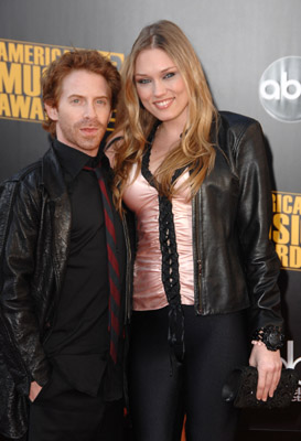 Seth Green and his date schlepped in from the Valley for this event, or what? That blouse is not even Forever 21. It's more like Mandee Shops.