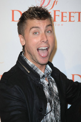 Look, *NSYNC was eons ago. Outside of Lance Bass being out and proud, what does he do bessides, what I hear, is gettting appearance money for various gay bars nationwide. Here he attends the Dizzy Feet event and I guess a dizzy