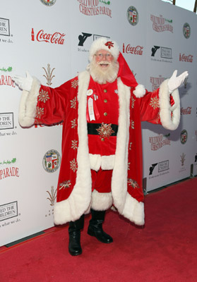 Oy, who is Santa's publicist? They should have never let him get photographed on teh Coca-Cola Red Carpet. It's like further proof of the theory that Coke is behind the whole commercialization of Christmas.