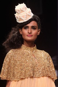 In honor of Kim Kardashian's wedding cake, which will be created by the same designer as Kate and William's, Lakme Fashion Week featured cake hats on the runway. Yes, Kris Jenner arranged this as well.