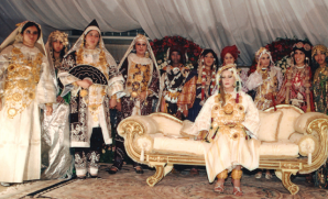 Talk aobut a royal wedding. Aisha Gaddafi and her beautfil bridesmaids look like a third grade Christmas play.