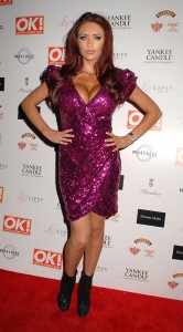 Amy Childs went to the OK! magazine Xmas party dressed as a big, tarty Christmas tree ornament.
