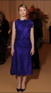 Mia Wasikowska is swimming in way too many yards of blue.