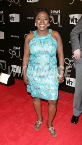 I love and own Sharon Jones' music, but someone please buy her CD. Sharon needs to afford a stylist.