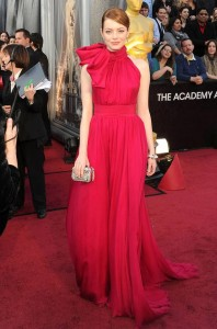 Emma Stone is being gobbled up by that bow on the side of her neck. Without it, on the best Dressed, with it, fotz.