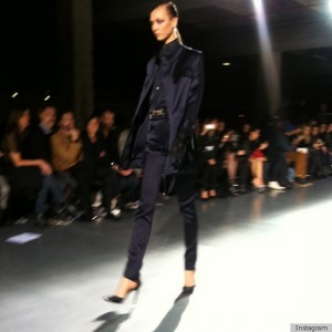 Karlie Kloss walks.