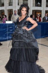 That is waaayyy too much dress June Ambrose. And if you are preganat... no.