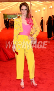 Coco Rocha wore Elizabeth Taylor's vintage Valentino jumpsuit. Can you tell that La Liaz was five feet zero inches. And what color shoes are those? Peach Melba?