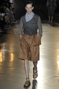 Damir Doma thinks a leather knee length skort is the must-have item for spring...for men. Girl, it's not even for women. It's call schvitzing.